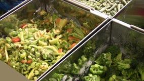 Buying frozen vegetables stock footage