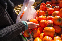 Buying fruit at a market stall Stock Images