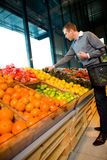 Buying Fruit and Vegetables Royalty Free Stock Images