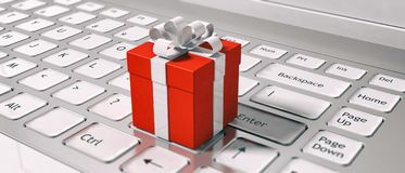 Red gift box on a computer keyboard. Ordering gifts online. 3d illustration Stock Images