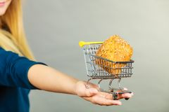 Woman hand holding shopping cart with bread stock photos