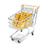 Buying gold. Gold bullions in shopping cart isolated on white background Royalty Free Stock Photo