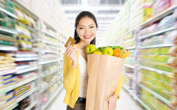 Buying groceries in marketplace Royalty Free Stock Images