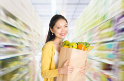 Buying groceries in supermarket Stock Images
