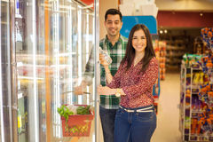 Buying healthy food at a store Royalty Free Stock Image