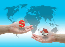 Buying house. Man hold dollar cash money for buying new house concept Stock Images