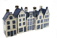 Buying a house. Delfst blue vintage ceramic houses in a row. Isolated on white. Part of a series Royalty Free Stock Photography