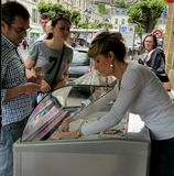 Buying ice cream from street vendor Royalty Free Stock Photography
