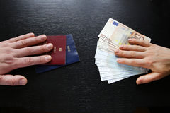 Buying illegal foreign passport hands exchanging money and documents. Buyer seller stock images