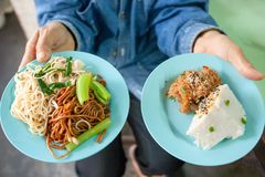 Buying local food of delicious Thai-Chinese home cooked, Chinese. Egg noodle with desserts, Sweet Sticky with Thai-Chinese Custard. Thai-Chinese local royalty free stock photos