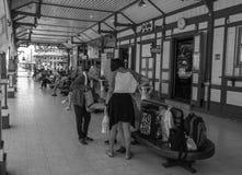 Buying lotto tickets at Hua Hin railway station Thailand. stock photography