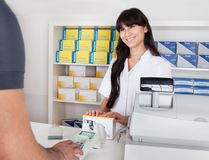 Buying medicine at pharmacy Stock Images