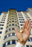 Buying new apartment. The hand holds a key highly Royalty Free Stock Image