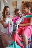 Buying new bicycle and helmet for little girl in bike shop. Buying new bicycle and helmet for happy little girl in bike shop stock photography