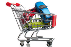Buying a new car. Some cars in a shopping cart - buying a new car
