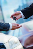 Buying a new car. In auto show or salon Royalty Free Stock Photography