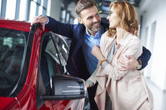 Buying new car by couple stock images