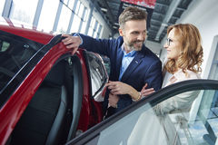 Buying new car by couple Royalty Free Stock Image
