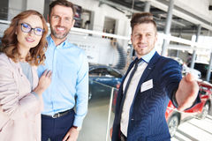 Buying new car by couple Stock Photo