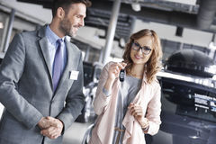 Buying new car by woman Stock Photo