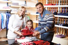 Buying new clothes Royalty Free Stock Images