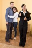 Buying new flat. Casual happy couple making transaction Royalty Free Stock Images