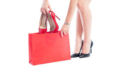 Buying new high heels red shoes on sale Stock Photo
