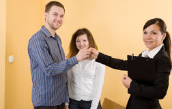 Buying new home. Casual and happy couple making transaction Stock Photo