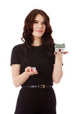 Buying new home concept - woman holding mini house. Isolated on white Royalty Free Stock Image
