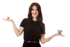 Buying new home concept - woman holding mini house. Isolated on white Royalty Free Stock Photo