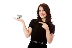 Buying new home concept - woman holding mini house. Isolated on white Royalty Free Stock Images