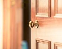 Buying new home, selling your home, inviting people over to your home, door knob, door handle, slightly opened wooden door in old stock image