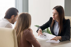 Buying new house concept, real estate agent consulting young cou Royalty Free Stock Photography