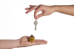 Buying a new house concept,. A women and man hand holding a model home and a key put together on isolate white background royalty free stock photos