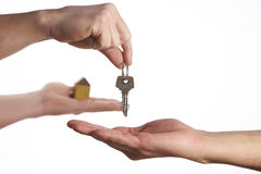 Buying a new house concept. A women and man hand holding a model home and a key put together on isolate white background stock images
