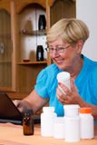 Buying online medicine. Senior woman researching and buying prescription medicines online Stock Photo