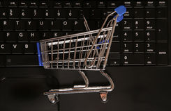 Buying online shopping trolley. Background Stock Photos
