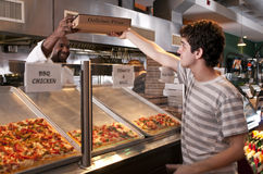 Buying pizza Stock Photography