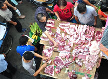 buying pork at market Royalty Free Stock Images