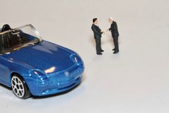 Buying and selling a car in miniature Stock Photo