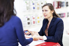 Buying a smart phone with cash Royalty Free Stock Photo
