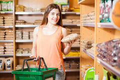 Buying some grains at a grocery store. Beautiful girl buying groceries and some grains in a supermarket stock photo