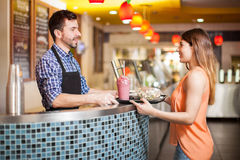 Buying some healthy food at a restaurant Royalty Free Stock Photo