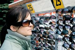 Buying sunglasses Royalty Free Stock Photos