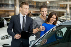 Buying their first car together. Royalty Free Stock Image