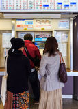 Buying Ticket from vending machines at Dazaifu Station Royalty Free Stock Photo