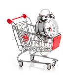Buying time concept with clock. And shopping cart Stock Image