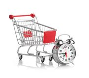 Buying time concept with clock. And shopping cart Stock Photos
