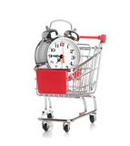 Buying time concept with clock. And shopping cart Royalty Free Stock Photography
