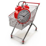 Buying time concept with clock and shopping cart Stock Images